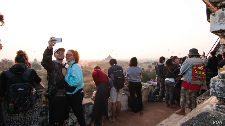 A couple pose for a selfie at Bagan, Myanmar. Climbing is permitted on selected monuments, such as Shwesandaw Pagoda. (Photo: John Owens for VOA)