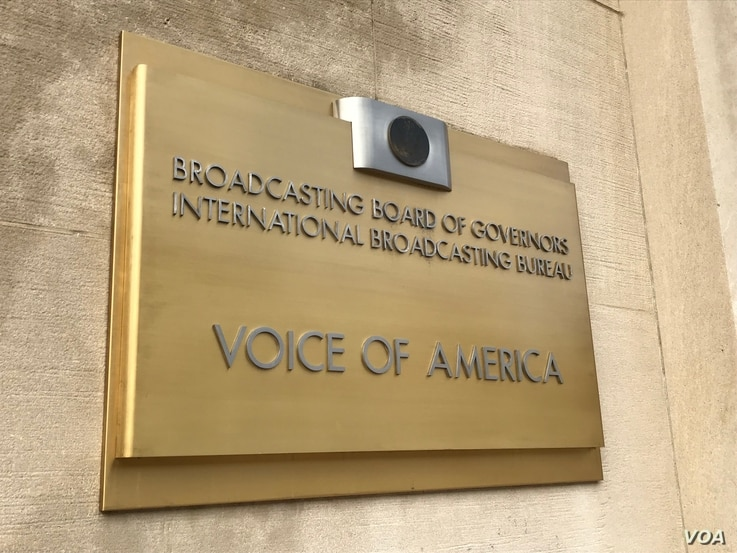 A Voice of America sign is seen at the entrance to VOA's headquarters in Washington, D.C.