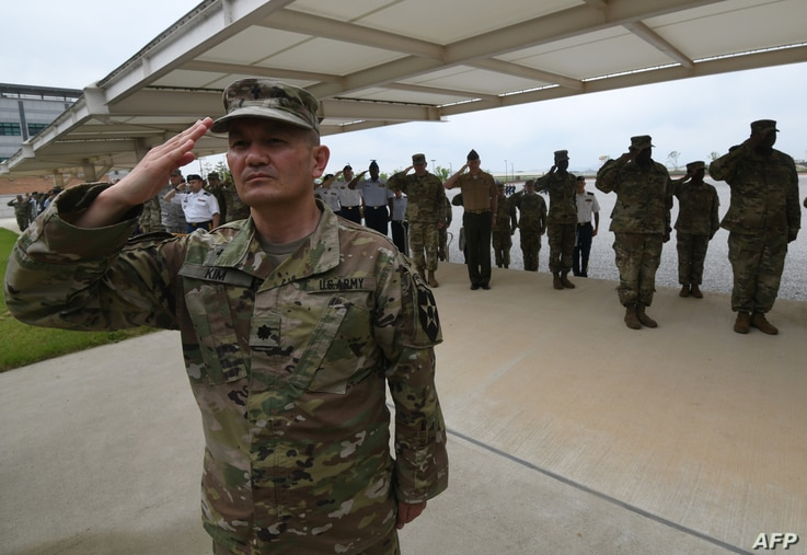 In this file photo taken on June 29, 2018, US soldiers salute during a grand opening ceremony of the new headquarters building for the United Nations Command and US Forces Korea at Camp Humphreys in Pyeongtaek.
