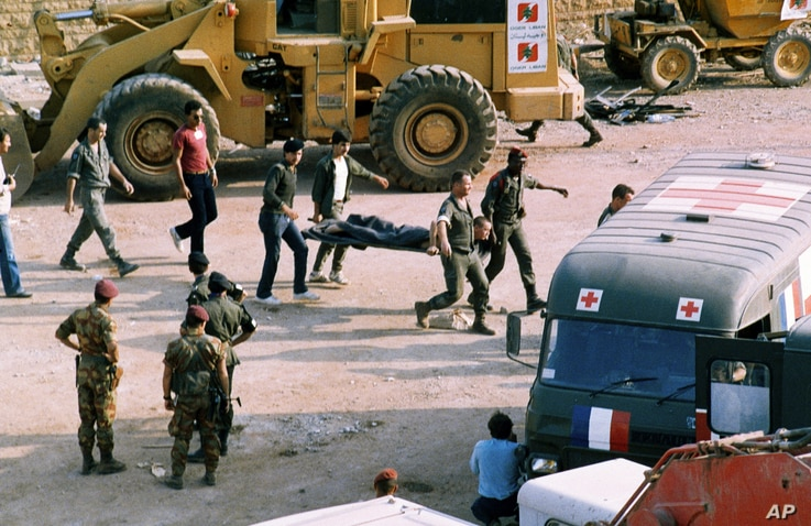 FILE - The scene at the U.S. Marine base near Beirut airport, Lebanon, following a suicide truck blast that destroyed the base and caused a huge death toll, Oct. 23, 1983.