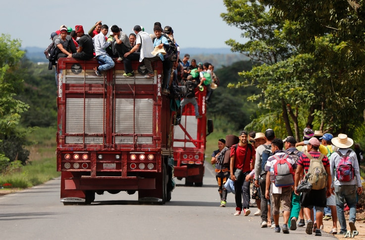Central American migrants, part of one of the caravans hoping to reach the U.S. border, get a ride on a truck, in Isla, Veracruz state, Mexico, Nov. 3, 2018.