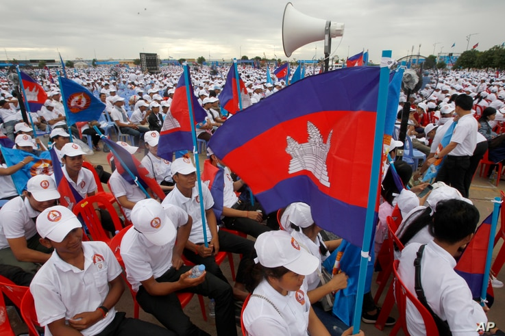 In this July 7, 2018, file photo, supporters wait for the start of a campaign rally of Cambodian Prime Minister Hun Sen's Cambodian People's Party in Phnom Penh, Cambodia.
