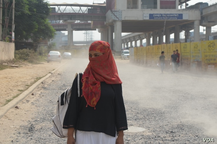 A woman on her way to work protects herself from hot winds in Gurgaon near New Delhi, India.