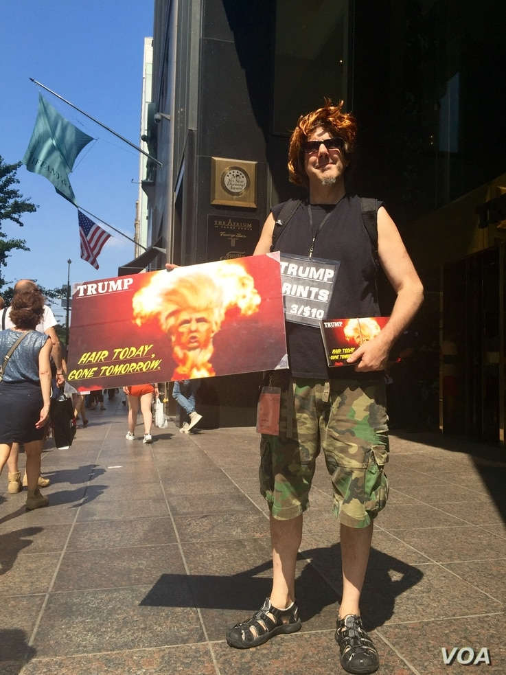 Paul Rosen regularly demonstrates outside Trump Tower.  He considers Clinton a war criminal for voting to invade Iraq, but still sees her as the better option against Trump. (R. Taylor/VOA)