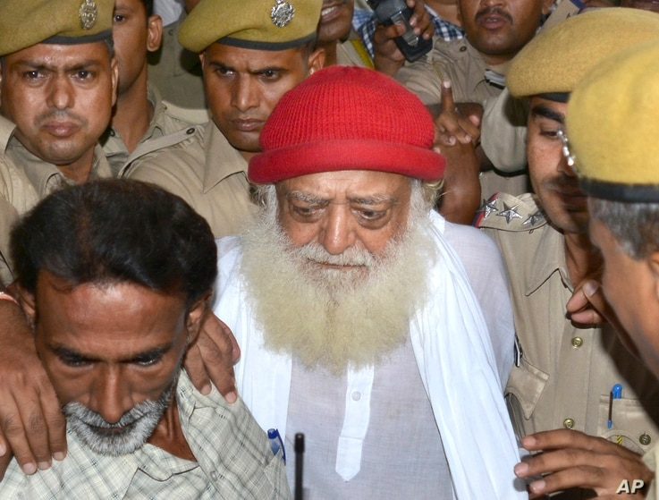 Asaram Bapu, a controversial spiritual guru who was arrested on Sept.1 on a rape charge filed by a teenage girl is brought to a hospital for a medical check up in Jodhpur, India, Sept. 9, 2013.