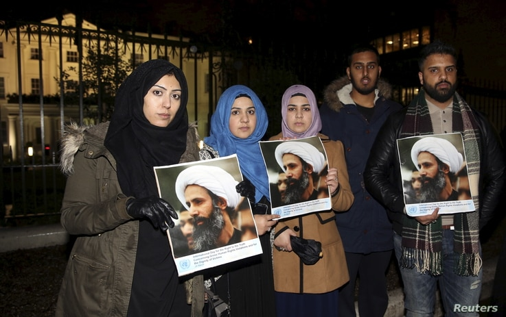 Protesters hold placards as they demonstrate against the execution of prominent Shi'ite cleric Sheikh Nimr al-Nimr outside the Saudi Arabian Embassy in London, Britain, Jan. 2, 2016.