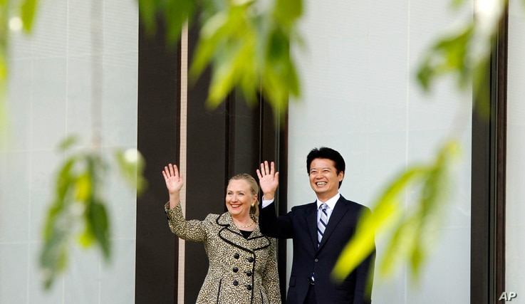 Clinton with Japanese Foreign Minister Koichiro Gemba  before a working lunch in Tokyo, July 8.