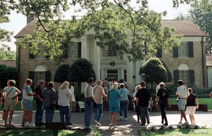 Elvis fans line up in front of Elvis Presley's Graceland Mansion in Memphis August 14 for one of the hundreds of daily tours conducted by Presley's estate.