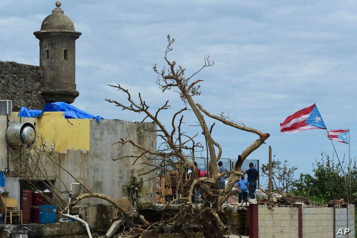 Residents at La Perla community in Old San Juan cling to their battered residences after the passing of Hurricane Maria, in San Juan, Puerto Rico, Sept. 25, 2017.