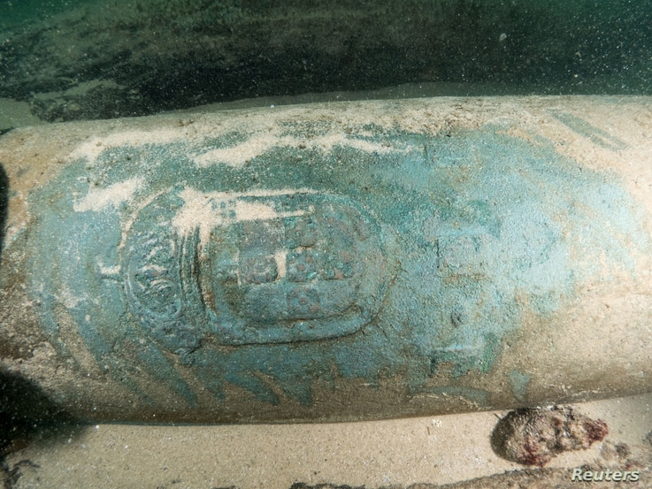 One of the nine nine bronze cannons engraved with the Portuguese coat of arms found by divers around a shipwreck near Cascais, Portugal, Sept. 24, 2018.