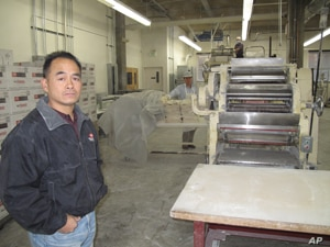 According to factory owner Tim Louie, fortune cookies make up about one-quarter of his business.
