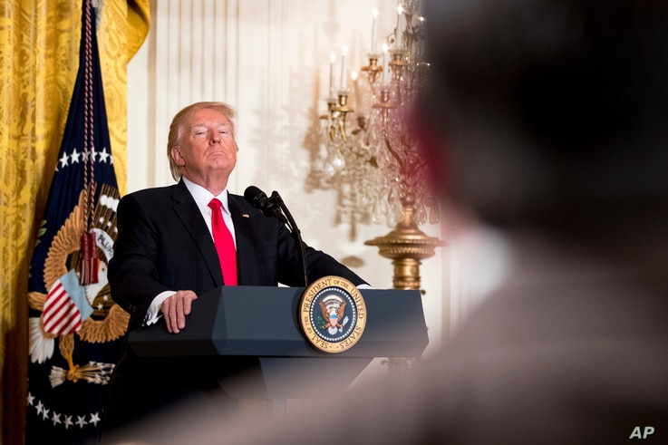 President Donald Trump takes a question during a news conference, Feb. 16, 2017, in the East Room of the White House in Washington.