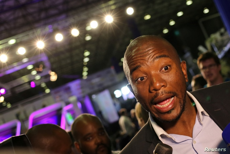 FILE - Democratic Alliance leader Mmusi Maimane gestures as he speaks to members of the media at the result center in Pretoria, South Africa, Aug. 4, 2016.