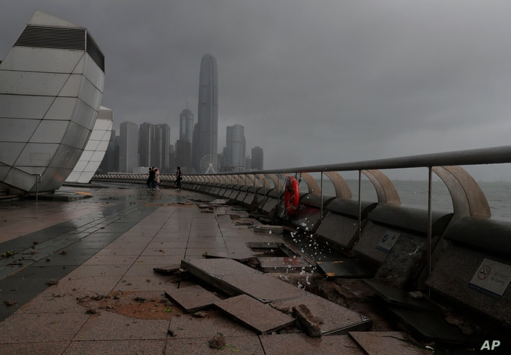 Debris caused by Typhoon Hato damage is strewn across  the waterfront of Victoria Habor in Hong Kong, Aug. 23, 2017.