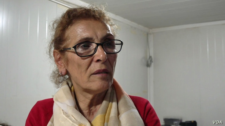 Zeynep Duzgunoglu one of 2000 people in Istanbul's Fikirtepe who gave up her home in exchange for the promise of new apartment in a luxury development.