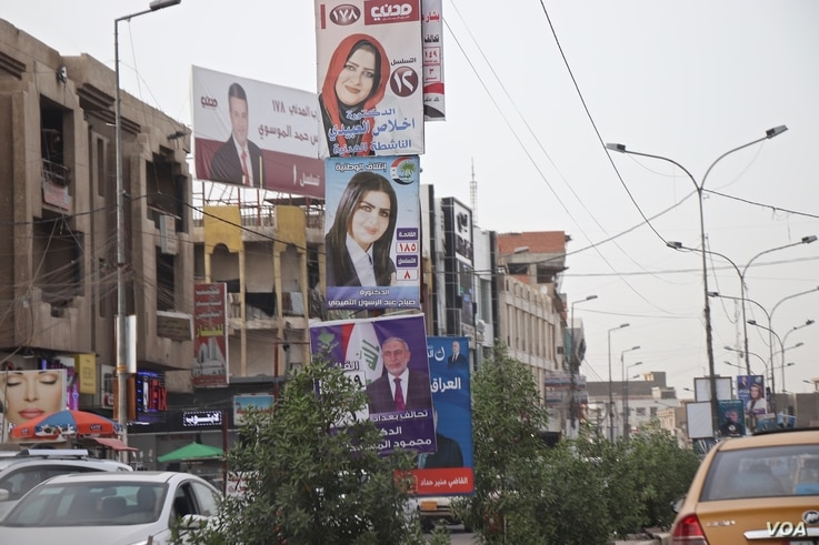 Campaign posters line the streets of Baghdad, May 7, 2018. (H.Murdock/VOA)