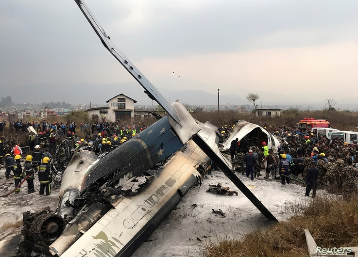 Wreckage of an airplane is pictured as rescue workers operate at Kathmandu airport, Nepal, March 12, 2018.