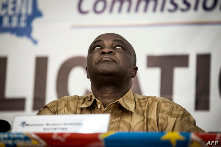 FILE - Vice President of the Commission Electorale Nationale Independante (CENI), Norbert Basengezi reacts during the announcement of the new electoral calendar for December 2018 presidential elections, Nov. 5, 2017 in Kinshasa.