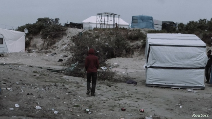 A still taken from BAFTA nominated short film 'Aamir', showing Aamir (played by Alan Asaad) in Calais, France.