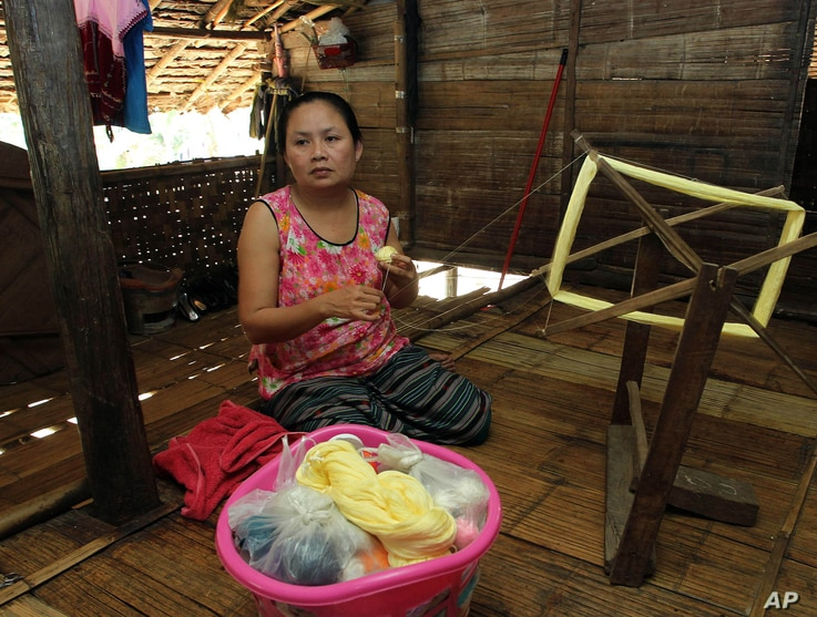 FILE - Mu Pro, a 42-year-old Karen refugee weaves while being interviewed at Mae La refugee camp in Ta Song Yang district of Tak province, northern Thailand, April 12, 2013.