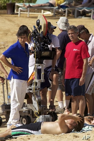 """""""The Descendants"""" director Alexander Payne (left) with star George Clooney during filming in Hawaii."""