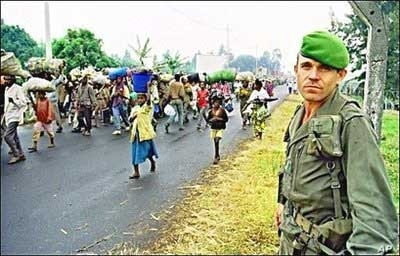 A French soldier watches as refugees flee Rwanda in July 1994 … Much of Sky Like Sky is concerned with the traumatic experience of crossing borders into the unknown