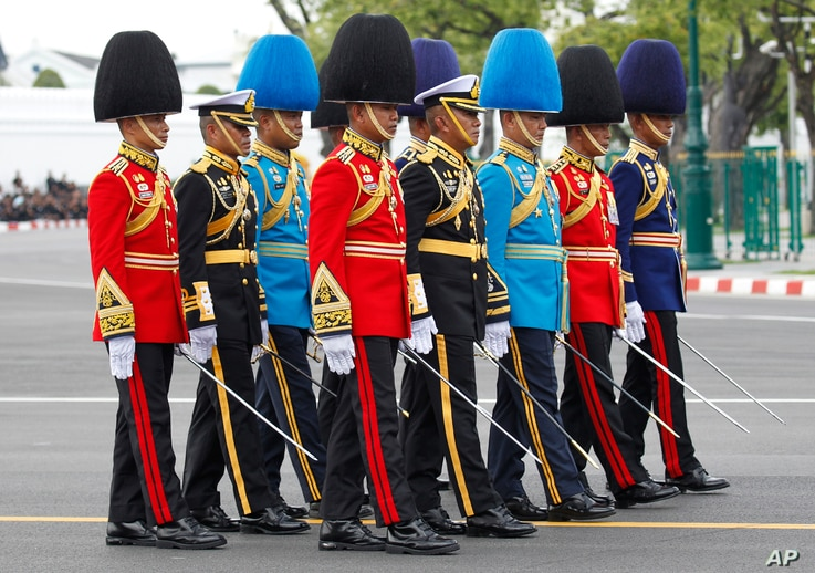 The royal honor guard walk in the funeral procession and royal cremation ceremony of late Thai King Bhumibol Adulyadej, in Bangkok, Thailand, Oct. 26, 2017.