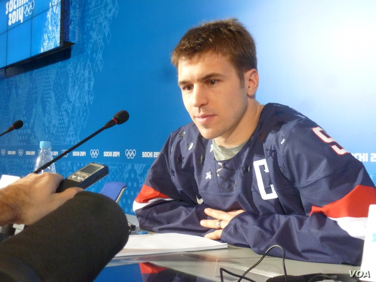 Zach Parise, the captain of the US Olympic ice hockey team, speaks to the media in Sochi, Feb. 11, 2014. (Parke Brewer/VOA)