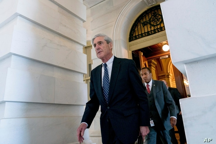 FILE - Special counsel Robert Mueller, in charge of investigating Russian interference in the 2016 U.S. presidential election and possible collusion between Moscow and the Trump campaign, departs Capitol Hill, in Washington, June 21, 2017, following