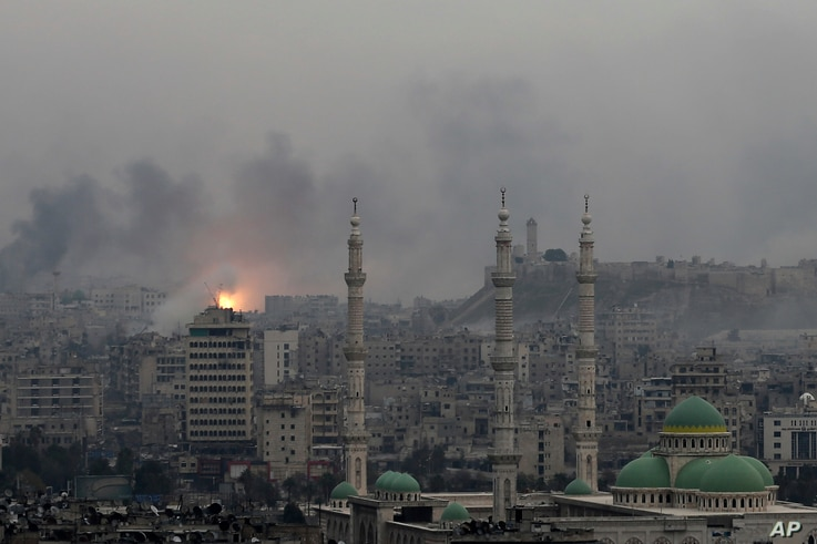 Dec. 5, 2016 file photo, a ball of fire rises following an air strike hits insurgents positions in eastern neighborhoods of Aleppo, Syria.