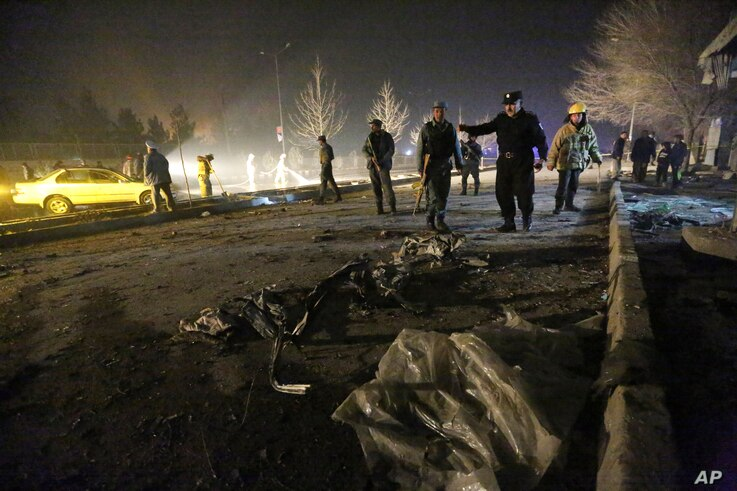 FILE - Afghan security forces inspect the site of a suicide attack near the Russian embassy in Kabul, Afghanistan. Conditions in Afghanistan are getting worse, 15 years into a war that few Americans talk about any more, Jan. 20, 2016.