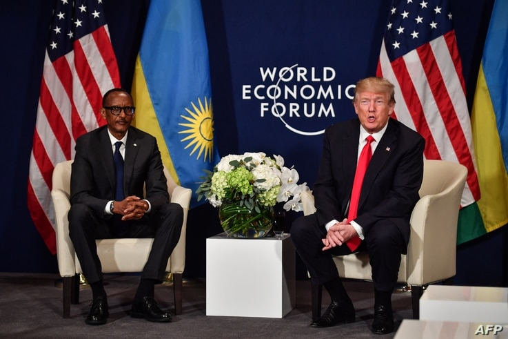 US President Donald Trump (R) and Rwandan President President Paul Kagame attend a bilateral meeting on the sideline of the annual meeting of the World Economic Forum (WEF) on January 26, 2018 in Davos, eastern Switzerland.  / AFP PHOTO / Nicholas Ka...