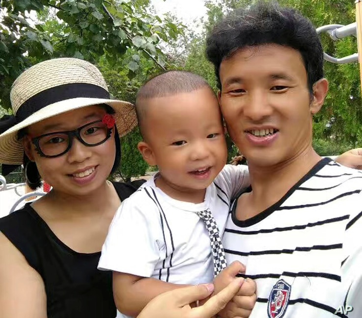 In this photo taken in 2016 and released by Deng Guilian, Deng Guilian, left, her husband Hua Haifeng, right, and their son Bo Bo pose for a photo during a visit to a park in Chengde in northern China's Hebei Province.