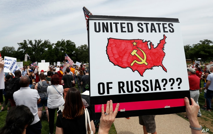 A protester holds a sign during a rally to protest President Donald Trump and his policies, on the National Mall in Washington, June 3, 2017.