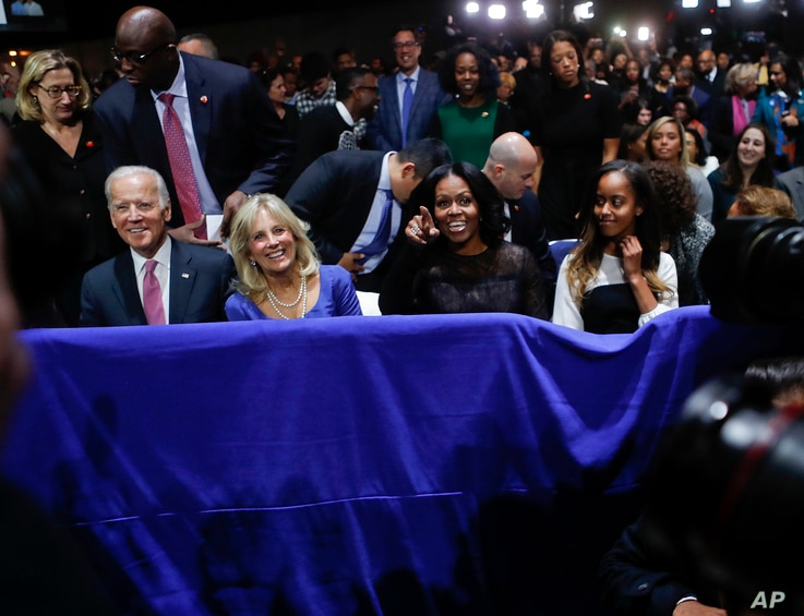 From left, Vice President Joe Biden, Jill Biden, first lady Michelle Obama and Malia Obama listen to President Barack Obama deliver his farewell address at McCormick Place in Chicago, Jan. 10, 2017.
