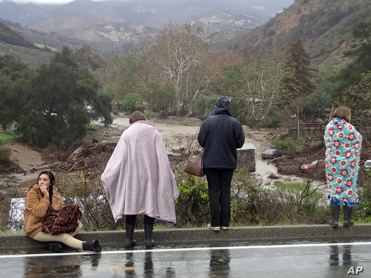 Rescued campers survey the scene at the El Capitan Canyon campground following flooding due to heavy rains, in Gaviota, Calif., Jan. 20, 2017.
