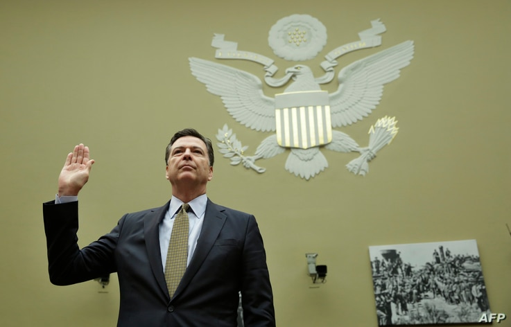 FBI Director James Comey is sworn-in before a House Oversight and Government Reform Committee hearing on Capitol Hill in Washington, D.C., July 7, 2016. .