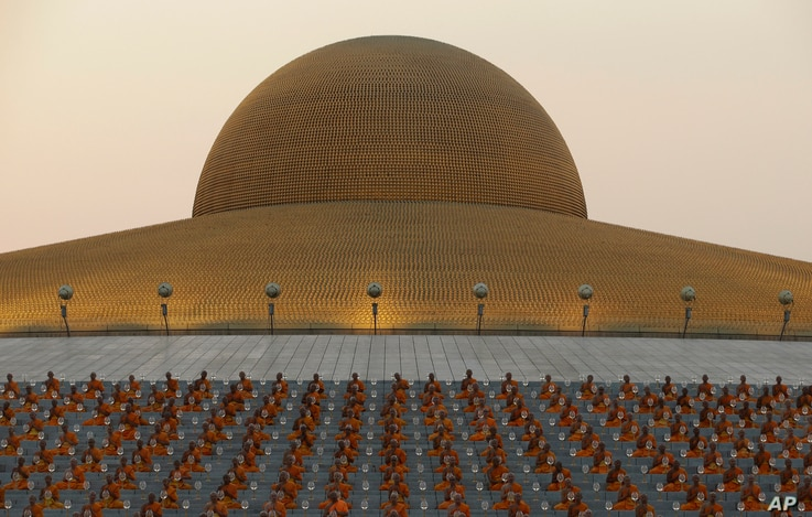 Thai Buddhist monks pray and gather at Wat Dhammakaya temple in Pathum Thani, Thailand, Feb. 22, 2016.