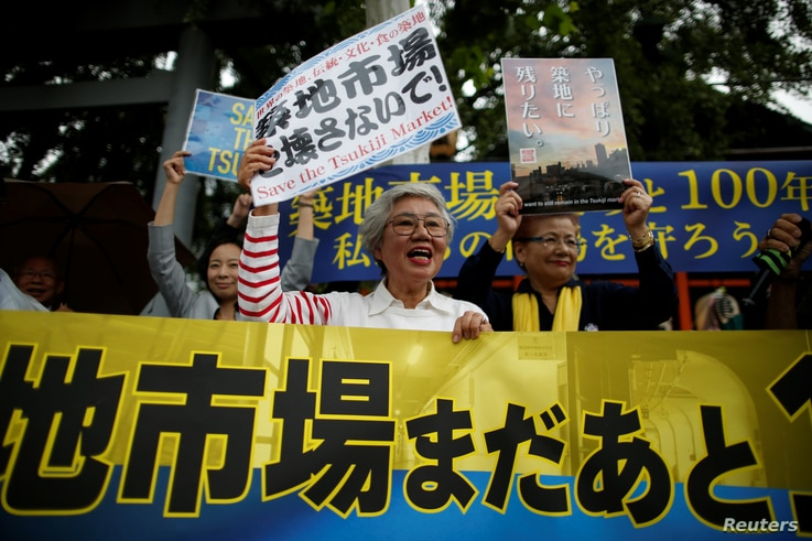 Tai Yamaguchi, 75, who has been tending her family's fish shop for more than 50 years in Tsukiji market, takes part in a rally denouncing market's relocation plan outside the Tsukiji market in Tokyo, Japan, Sept. 29, 2018.