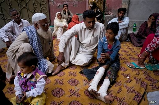 Parents Burying Children Killed in Pakistan Terror Attack