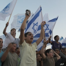 Settler youth from the settlement of Itamar in the West Bank march down a highway to demonstrate their ownership of the land, September 21, 2011