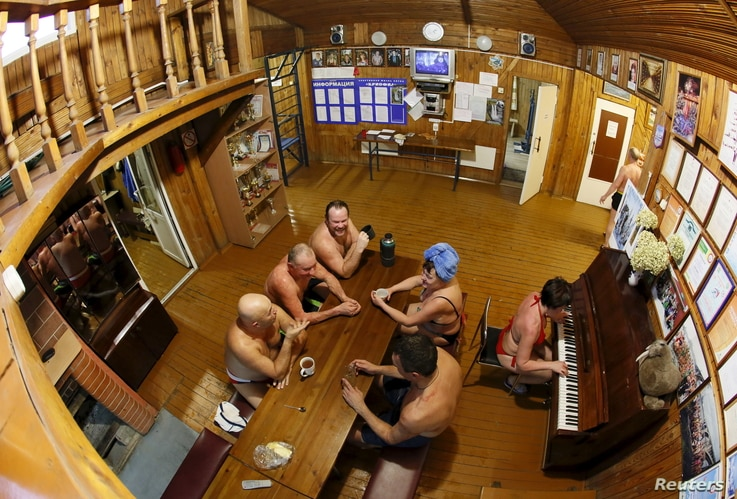 Members of the Cryophile winter swimmers club gather inside the wooden clubhouse on the banks of the Yenisei River in the Siberian city of Krasnoyarsk, Russia, Dec. 13, 2015.