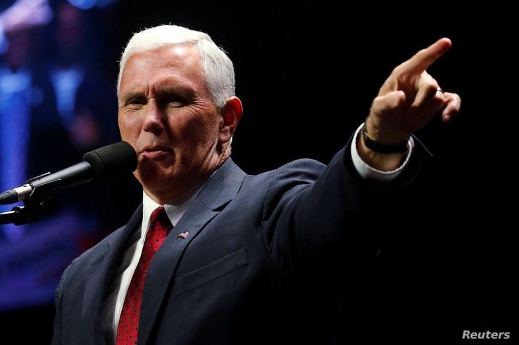 Republican vice presidential nominee Mike Pence attends a campaign rally in Manchester, New Hampshire, Nov. 7,  2016.