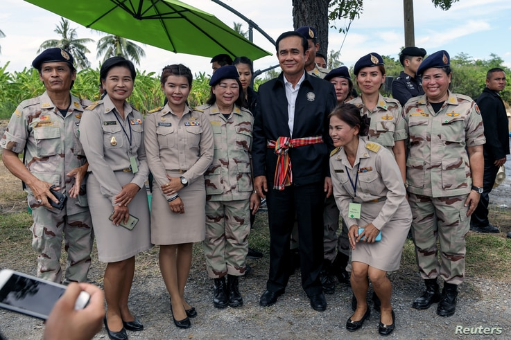 Thailand's Prime Minister Prayuth Chan-ocha poses for photo with local government officers at a farmer school in Suphan Buri province, Thailand, Sept. 18, 2017.