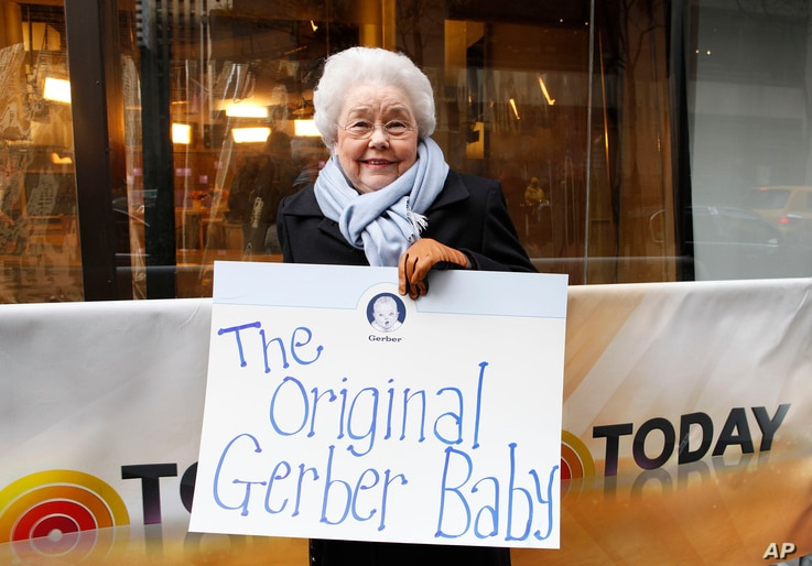 FILE - Ann Turner Cook, whose baby face launched the iconic Gerber logo, arrives at NBC's Today Show to announce the winner of the 2012 Gerber Generation Photo Search, Nov. 6, 2012, in New York City.