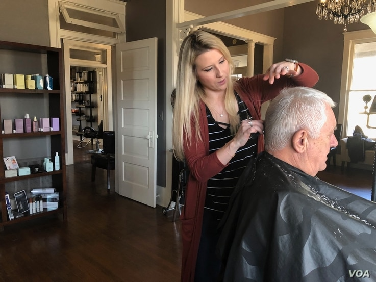 Hair stylist Ashley Holland said the new minimum wage might lead to more clients who can afford her services, but she also worries the increase might affect other local businesses – some already struggling to get by – and their ability to pay the...