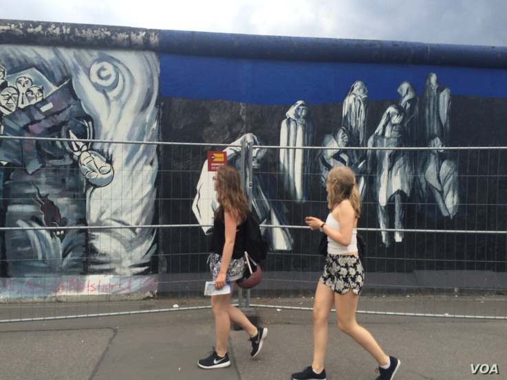 Much of the wall is painted, with artists displaying everything from the horrors of suffering to unity, June 30, 2016.