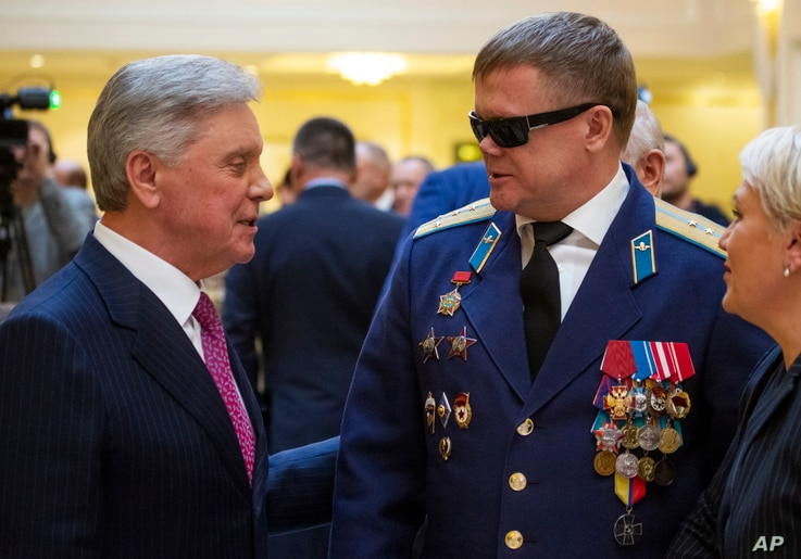 Vladimir Vshivtsev, a veteran of the Soviet war in Afghanistan, right, and Gen. Col. Boris Gromov, former Commander of the 40th Army in Afghanistan, greet each other during a meeting at the upper chamber of Russian parliament in Moscow, Russia, Feb. ...