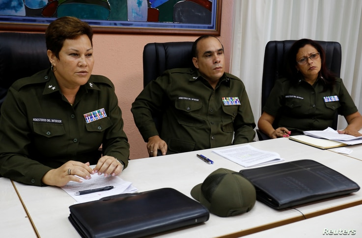 Cuban Interior Ministry officials Lieutenant Colonels Imandra Oceguera, Marco Rodriguez and Dalgys Lamorut attend an interview with Reuters, in Havana, Cuba, May 31, 2017.