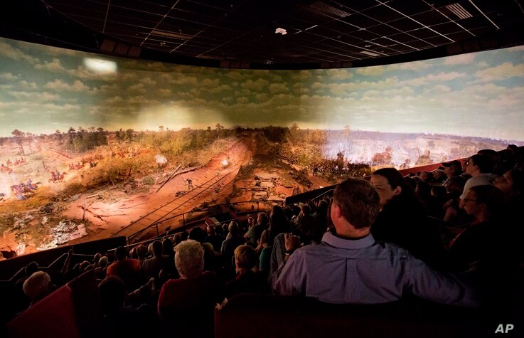 Visitors view the Atlanta Cyclorama, the colossal Civil War painting created about 130 years ago, June 30, 2015, in Atlanta.